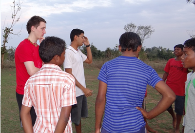 Physiologist, Gareth Sandford, and School Sports Coordinator, Rohan Kandoi (both back left) debrief some of the student athletes new to Khel Vikas school sports.