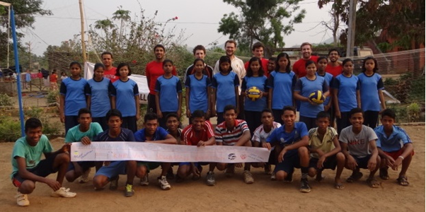 The boys and girls of the Kankia teams alongside staff at the Khel Vikas Volleyball Exhibition celebrating International Day of Sport for Development and Peace.