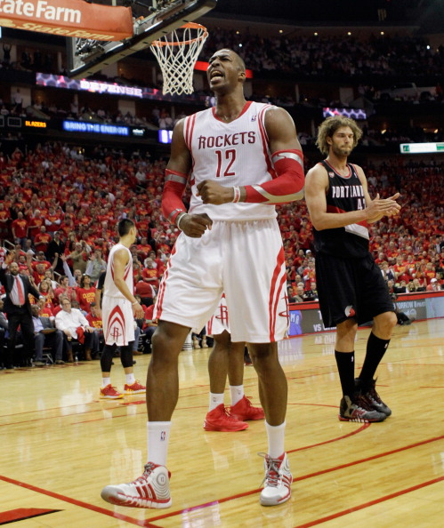 Dwight Howard #12 of the Houston Rockets gets the crowd going after a defensive stop with less than two minutes to go in Game 5 of the Western Conference Quarterfinals during the 2014 NBA Playoffs at the Toyota Center on April 30, 2014 in Houston, Texas. Houston won 108-98.