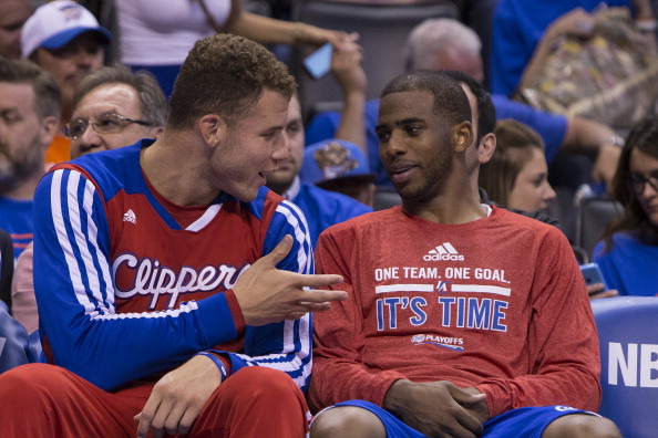 Blake Griffin #32 and Chris Paul #3 of the Los Angeles Clippers sit on the bench in Game 1 of the Western Conference Semifinals against the Oklahoma City Thunder during the 2014 NBA Playoffs at the Chesapeake Arena on May 5, 2014 in Oklahoma City, Oklahoma.