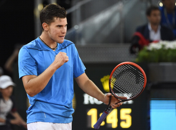 Austrian player Dominic Thiem celebrates after winning his men's singles second round tennis match against Swiss player Stanislas Wawrinka at the Madrid Masters at the Magic Box (Caja Magica) sports complex in Madrid on May 6, 2014.
