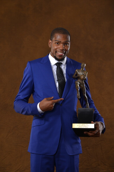 Kevin Durant of the Oklahoma City Thunder poses for a portrait with the Maurice Podoloff Trophy after being named the 2013-14 KIA Player of the Year on May 6, 2014 at the Thunder Events Center in Edmond, Oklahoma.