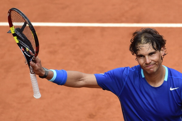 Spanish player Rafael Nadal celebrates after winning his men's singles second round tennis match against Argentinian player Juan Monaco at the Madrid Masters at the Magic Box (Caja Magica) sports complex in Madrid on May 7, 2014.