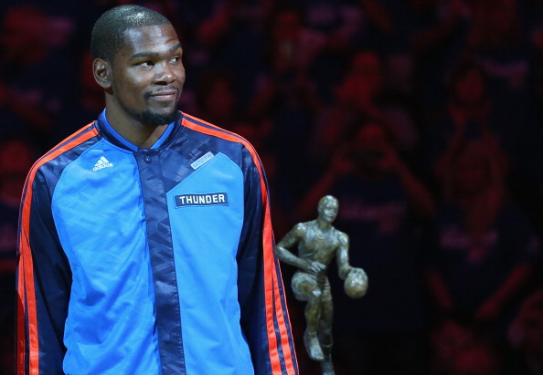 Kevin Durant of the Oklahoma City Thunder with the Maurice Podoloff Trophy after being named the 2013-14 KIA Player of the Year before Game Two of the Western Conference Semifinals during the 2014 NBA Playoffs at Chesapeake Energy Arena on May 7, 2014 in Oklahoma City, Oklahoma.