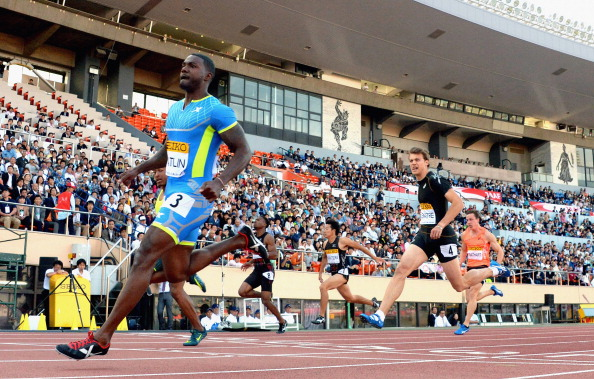 Justin Gatlin (L) of USA reacts after winning the Men's 100m during the Seiko Golden Grand Prix Tokyo 2014 at the National Stadium on May 11, 2014 in Tokyo, Japan.