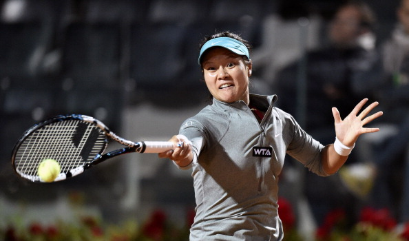 Na Li of China  returns a ball  to Casey Dell'Acqua during their match as part of Rome WTA tennis Masters on May 13, 2014 at the Foro Italico in Rome.