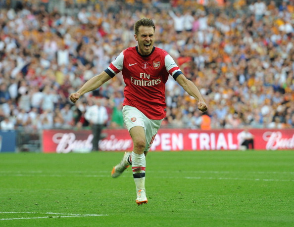 Aaron Ramsey celebrates after scoring the winner in the FA Cup final to hand Arsenal a trophy after 9 years