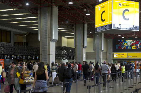 Passengers are seen at Sao Paulo International Airport, in Guarulhos, Brazil