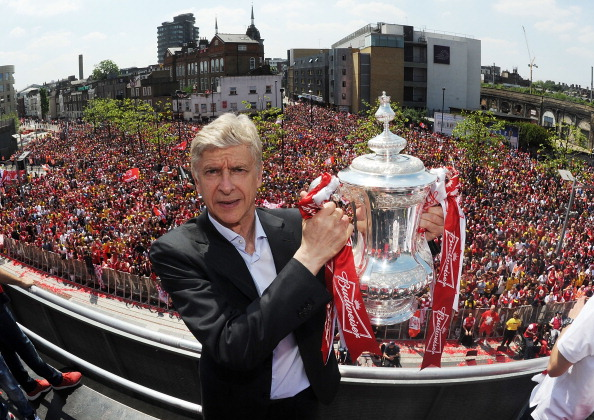 Arsene Wenger with the FA Cup trophy