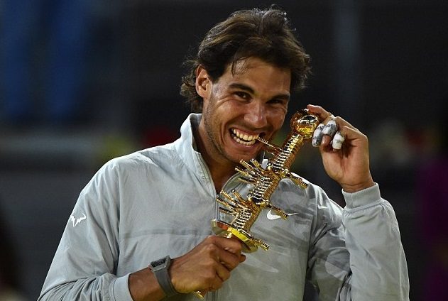 Rafael Nadal with his 'bite' of the Madrid Masters