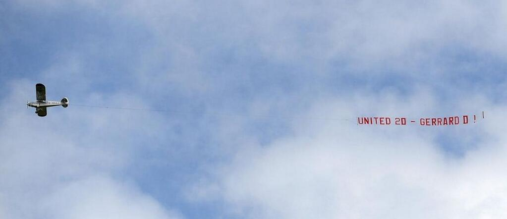 Airplane with the banner 'United 20 - Gerrard 0' flies over Anfield