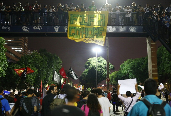Demonstrators display a sign that reads 'FIFA Go Home' at a protest against the upcoming 2014 World Cup on May 15, 2014 in Rio de Janeiro, Brazil.