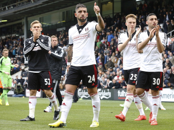 Fulham players applaud their fans after their last Premier League game