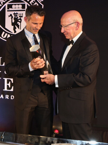Ryan Giggs (right) is presented with the Lifetime Achievement award by Sir Bobby Charlton