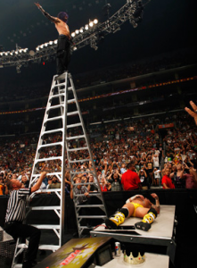 Jeff Hardy on top of a ladder ready to dive on CM Punk.