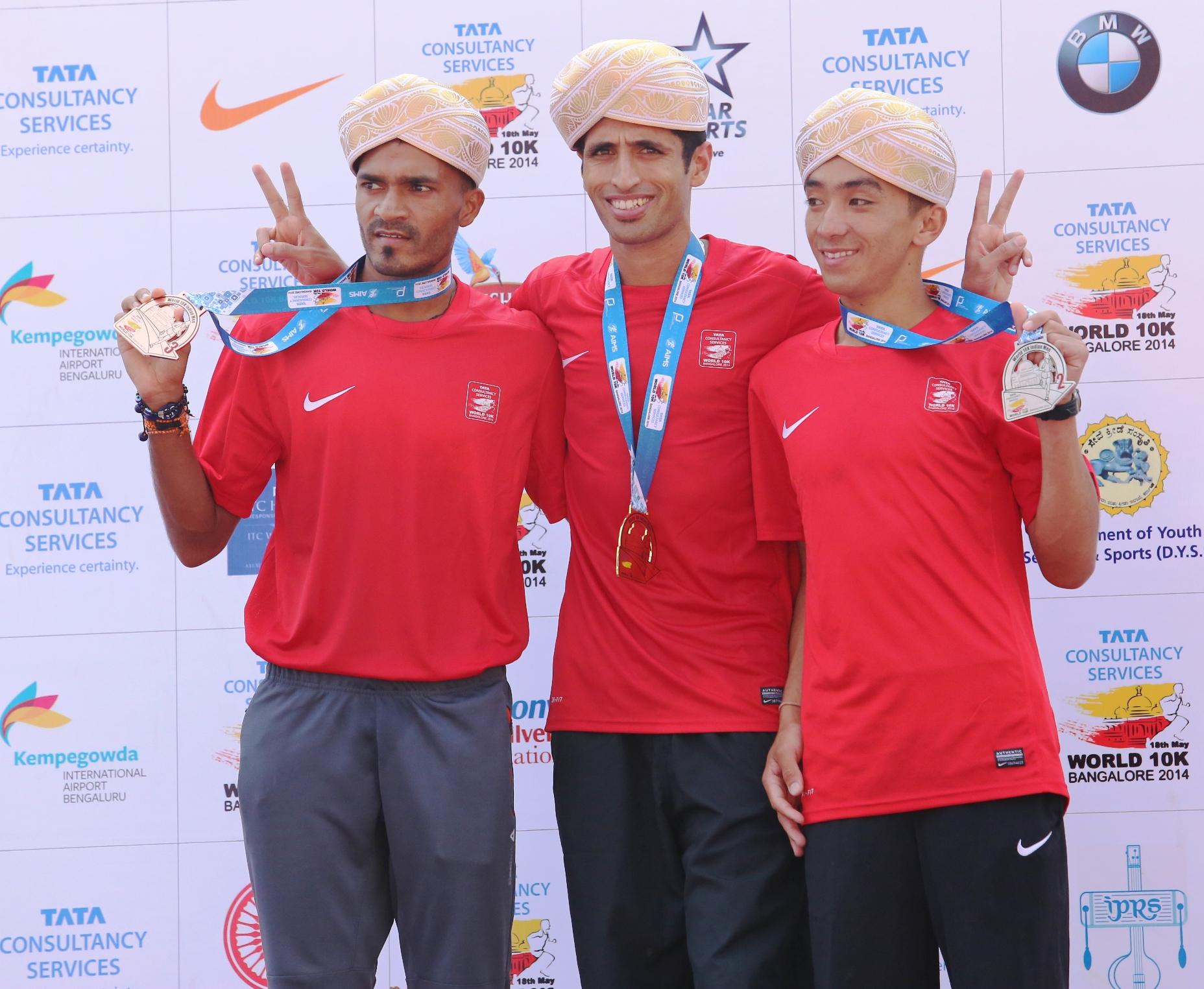 The Indian men's winners of the TCS World 10K Bangalore, 2014 (from left) 1st runner up Nitendra Singh Rawat, Winner B. C. Tilak and 2nd runner up Anish Thapa.