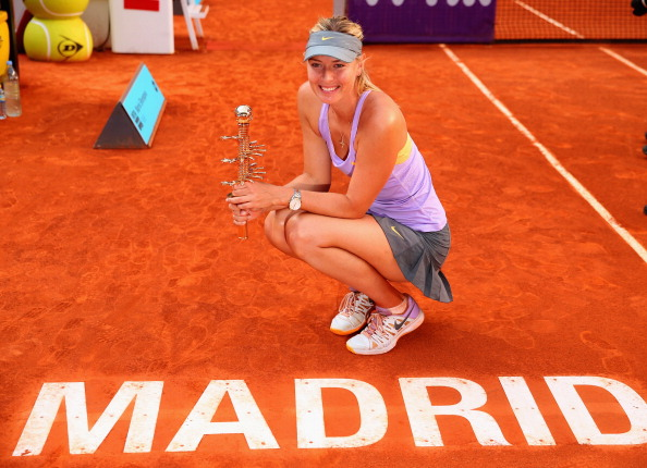 Maria Sharapova posing with the trophy after defeating Simona Halep in the Madrid final