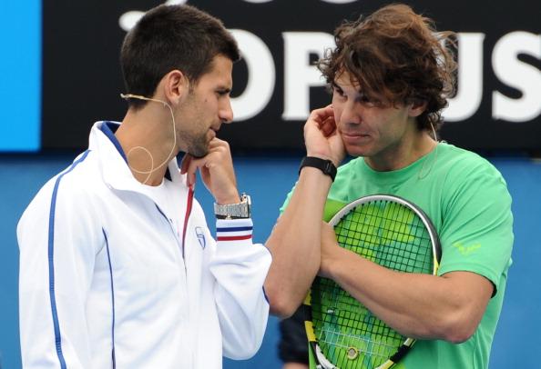 Novak Djokovic of Serbia (L) speaks with