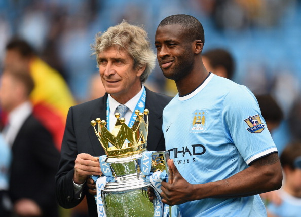 Manchester City Manager Manuel Pellegrini and Yaya Toure pose