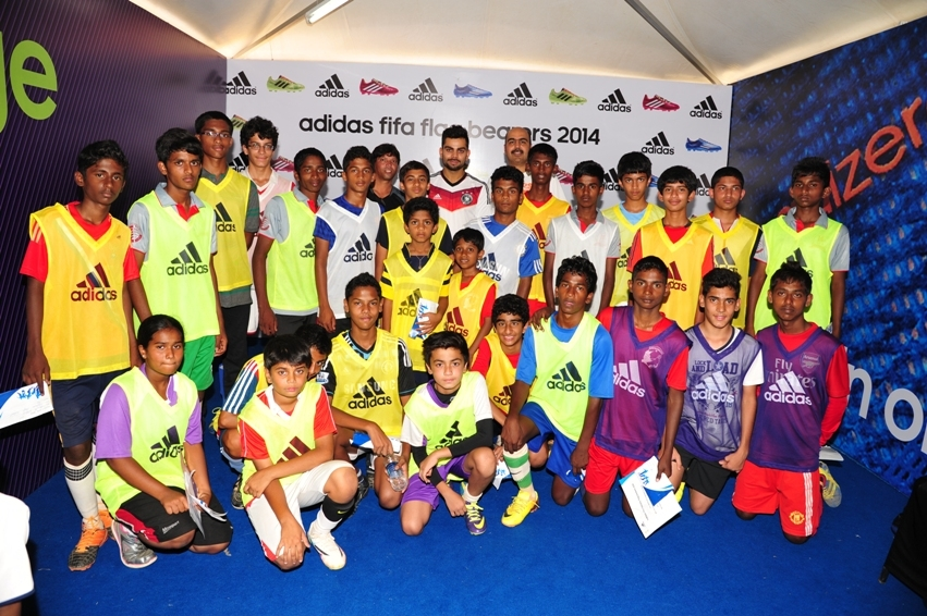 Virat Kohli with the kids at the adidas FIFA flagbearres program in Bangalore