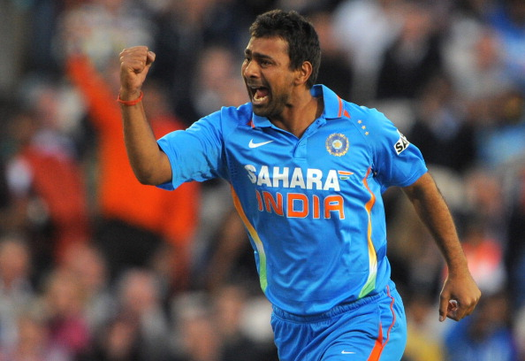 India's Praveen Kumar celebrates after t