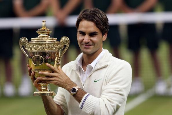 Roger Federer holding aloft his 17th Grand Slam trophy at Wimbledon in 2012