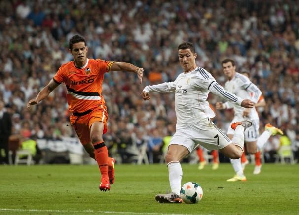 Ronaldo vies for the ball with Valencia's Ricardo Costa.