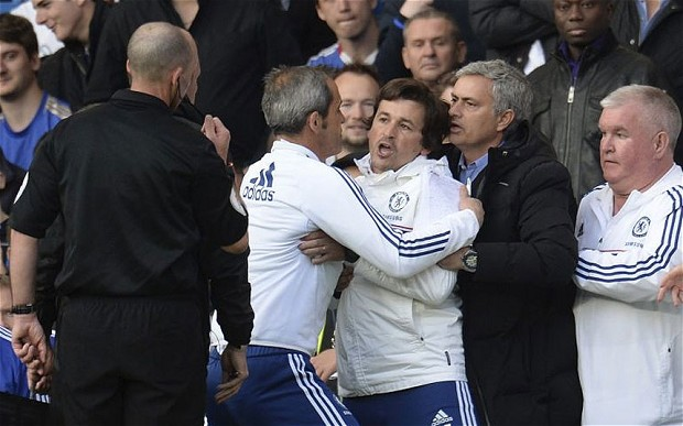 An infuriated Rui Faria being taken away by the Chelsea staff