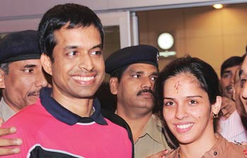 Saina Nehwal with her coach Pullela Gopichand