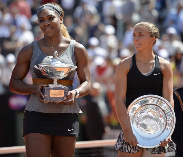 Serena Williams (L) of the US poses with the trophy after winning the WTA Rome's Tennis Masters final against Sara Errani (R) of Italy on May 18, 2014, at the Foro Italico in Rome. Williams won 6-3, 6-0.