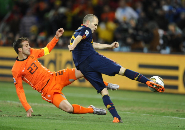 Spain's midfielder Andrés Iniesta (R) shoots and scores a goal during extra time the 2010 FIFA football World Cup final between the Netherlands and Spain on July 11, 2010 at Soccer City stadium.