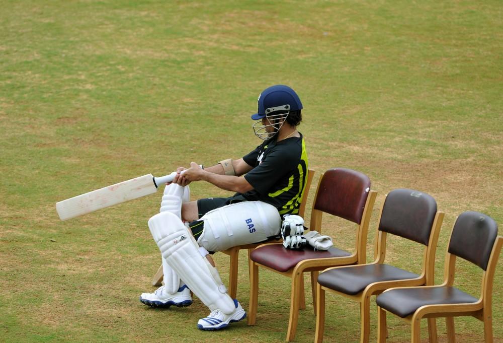 Sachin Tendulkar checks his bat during a practice session