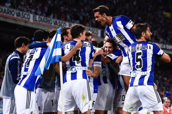Carlos Vela Garrido (L) of Real Sociedad celebrates with his teammates after scoring his team's fourth goal