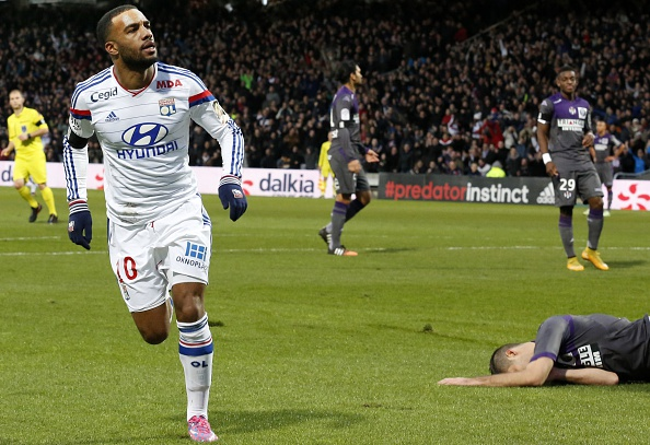 Lyon's French forward Alexandre Lacazette celebrates after scoring a goal during the French L1 football match Lyon (OL) vs Toulouse