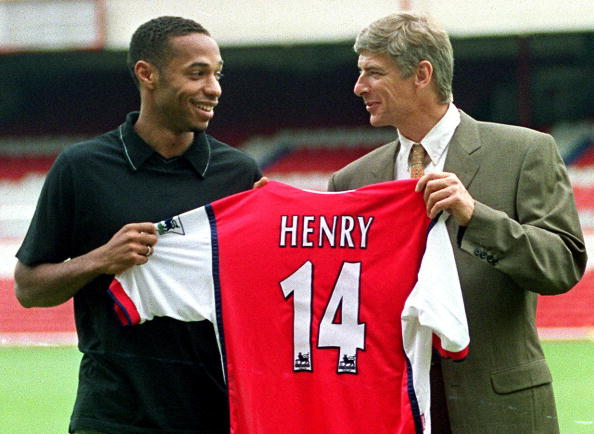 5e8cb6699 Striker Thierry Henry holds up his shirt with Manager Arsene Wenger having  been signed for Arsenal in 1999