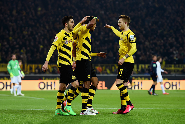 Pierre-Emerick Aubameyang of Borussia Dortmund celebrates with team mates as he scores the third goal during the Bundesliga match between Borussia Dortmund