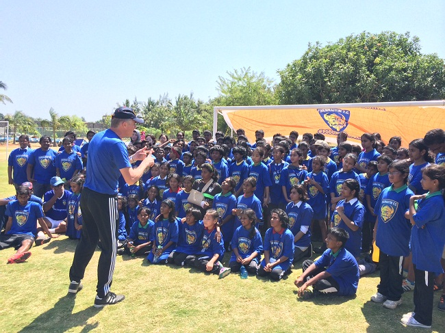 ISL Grassroots Technical Director Piet Hubers interacts with the participating kids