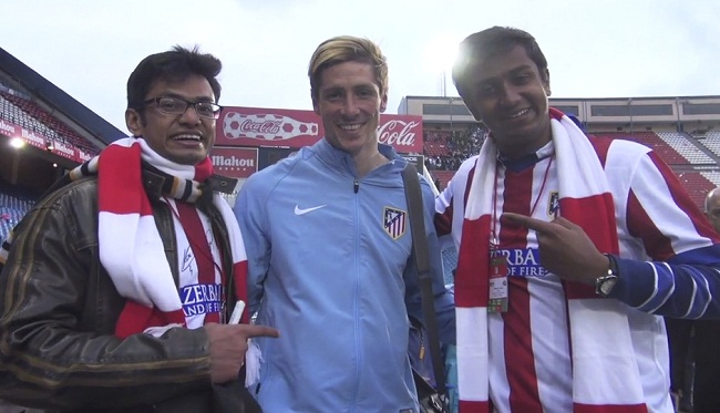 Atletico Madrid fan Dhananjay Yadav (L) won a contest to watch his team live at the Vicente Calderon in the Madrid derby