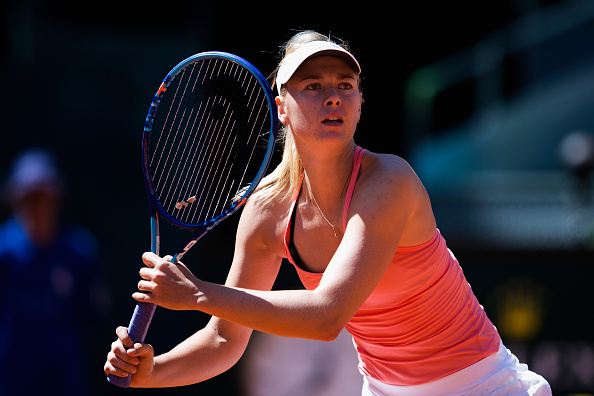 Maria Sharapova survives a scare against Caroline Garcia to reach the quarterfinals of Madrid Open
