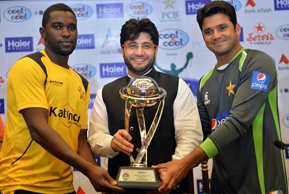 Captains Elton Chigumbura (L) and Azhar Ali (R) pose with the ODI series trophy
