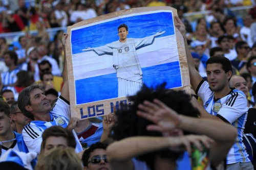 Argentina fans with a Lionel Messi placard