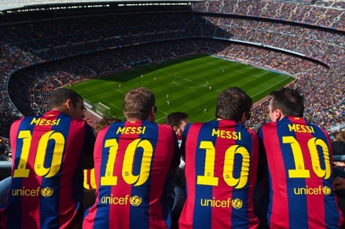 Lionel Messi and FC Barcelona fans enjoying a La Liga match from the stands