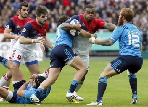 Rugby Union - France vs Italy - Stade de France, Paris, France - 6/2/16. France's Virimi Vakatawa (C) in action with Italy's Gonzalo Garcia (R) and Lorenzo Cittadini (L) during a Six Nations tournament match. REUTERS/Gonzalo Fuentes