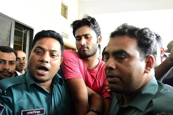 Shahadat Hossain (C) after he surrendered in Dhaka
