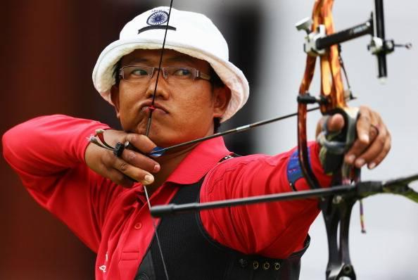 Tarundeep Rai taking aim in an earlier competition