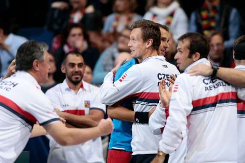 Lukas Rosol of Czech celebrates with teammates after the match