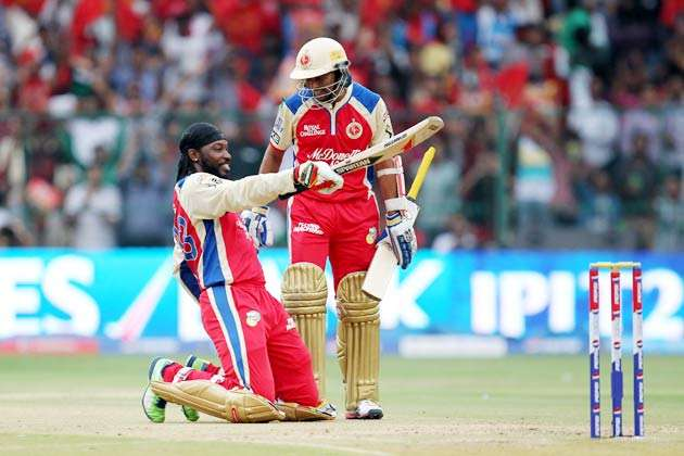 Chris Gayle celebrates after reaching his 100 during his unbeaten 175