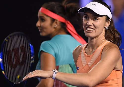 All smiles: Sania Mirza (left) and Martina Hingis are back in a WTA final
