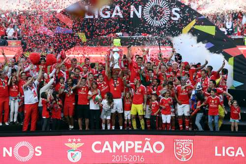 Benfica's defender Luiso raises the trophy and celebrates with teammates
