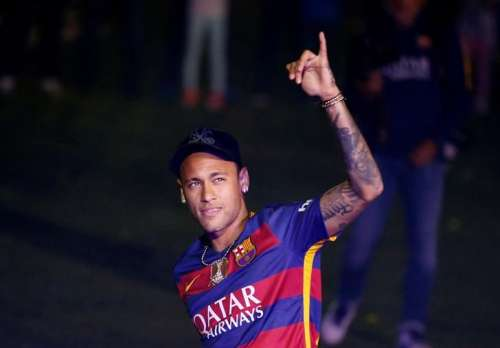 Barcelona's Neymar salutes the crowd during a ceremony celebrating the club's season at Camp Nou stadium in Barcelona, Spain, May 23, 2016. REUTERS/Albert Gea/File Photo